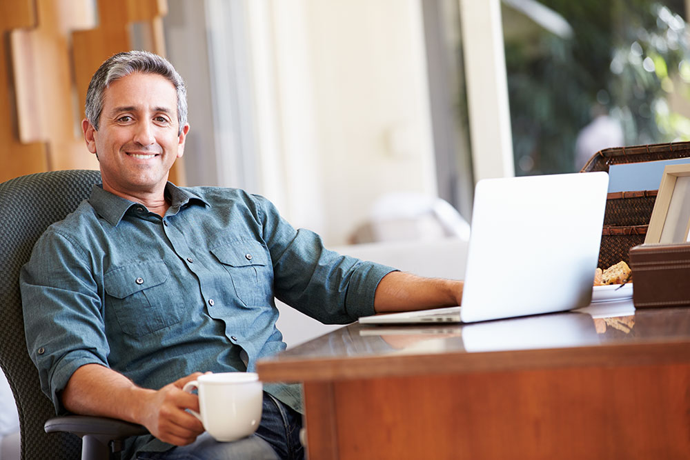 Mature-Hispanic-Man-Using-Laptop